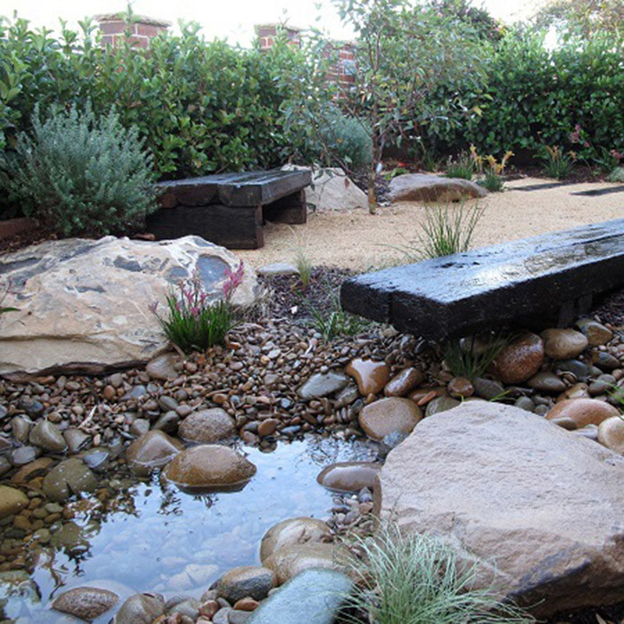dry creek bed with rocks, steps and benches - landscape design