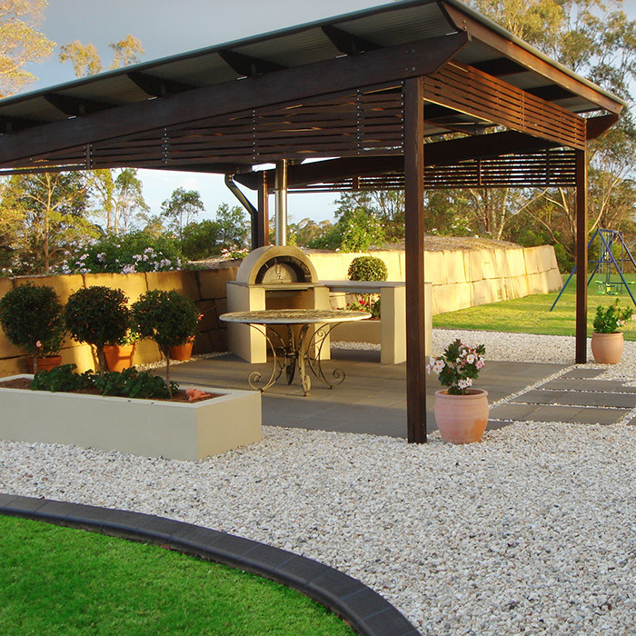 formal entertaining area topiaries in rendered raised garden beds and lawn maintenance