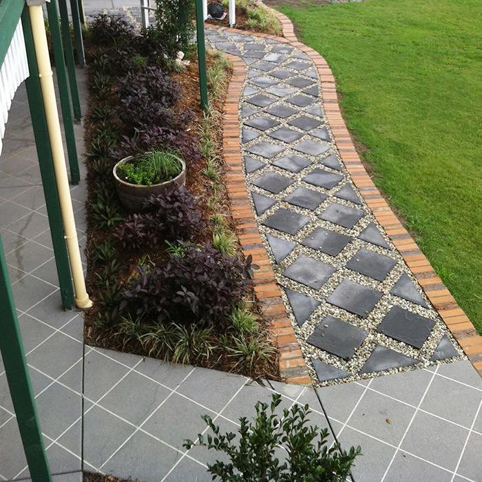 matching decorative concrete and entry path design